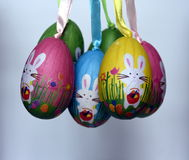 Bunch of colourful panted plastic eggs with white bunnies. Easter or Paschal eggs are used as gifts. Easter Bunny Easter Rabbit or Hare is a folkloric figure Stock Images