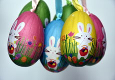 Bunch of colourful panted plastic eggs with white bunnies. Easter or Paschal eggs are used as gifts. Easter Bunny Easter Rabbit or Hare is a folkloric figure Stock Image