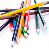 Bunch of colourful pencil crayons on white Royalty Free Stock Photos