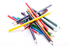 Bunch of colourful pencil crayons on white stock photos