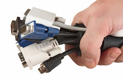 Bunch of computer cables with  sockets in hand Royalty Free Stock Photos