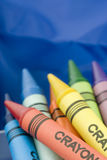 Bunch of crayons. Bunch of colorful crayons on blue background stock photos