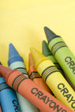 Bunch of crayons. Bunch of colorful crayons on a yellow background stock image