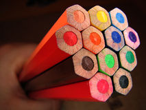 Bunch of Crayons. Bunch of colorful wooden crayons held in hand, back side royalty free stock photos