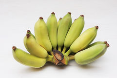 Bunch of Cultivated bananas or Thai bananas on white wooden background royalty free stock photography