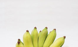 Bunch of Cultivated bananas or Thai bananas on white wooden background. royalty free stock images