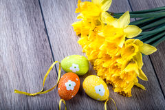 Bunch of daffodils with easter eggs for Easter Royalty Free Stock Photos
