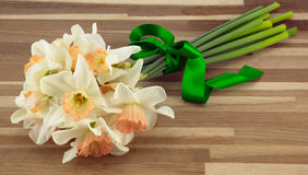 Bunch of daffodils. Bunch of daffodils tied with green ribbon Royalty Free Stock Photo