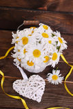 Bunch of daisies on wooden background Stock Photos