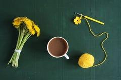 Bunch of dandelions, crocheting and coffee Stock Photo