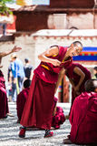 A bunch of debating Tibetan Buddhist monks at Sera Monastery. This event is a famous activity at Sera Monastery in Lhasa, Tibet. A group of Lama are separated royalty free stock image