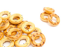Bunch of delicious bagels on white. Bunch of tasty bagels on white background closeup Royalty Free Stock Photos