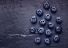A bunch of delicious blueberry on slate Stock Photos