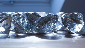 Bunch of diamonds on surface. Bunch of diamonds on a surface breaking the sunlight casting light on surface Stock Images