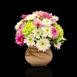 Bunch different flowers in clay vase Stock Photos