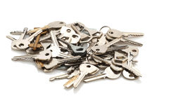 A bunch of different keys from the door on a white background Stock Photos