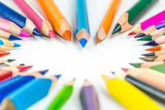 Bunch of different and multicolored pencils forming heart Royalty Free Stock Photos
