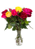 Bunch of different roses in a glass vase Stock Photo
