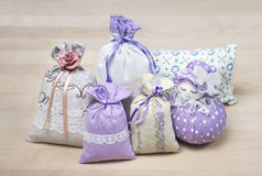 Bunch of different scented sachets for decoration on wooden board. Many fragrant pouches on table. Aromatic potpourri set. Bags filled with lavender royalty free stock photography