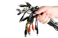Bunch of different wires in male hand. Bunch of different wires in male hand on white background Stock Image