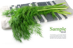 Bunch of dill on a kitchen towel, isolated, corner background, Royalty Free Stock Image