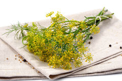 Bunch of dill with linen napkin on white background Stock Photo