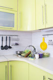 A bunch of dirty dishes in the kitchen. Stock Photo