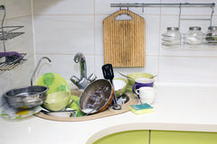 A bunch of dirty dishes in the kitchen. Royalty Free Stock Images