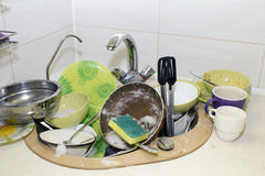 A bunch of dirty dishes in the kitchen. A bunch of dirty dishes in the kitchen Royalty Free Stock Image