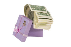 Bunch of dollar bills in a gift box. Bunch of one-dollar bills in a lilac gift box (isolated on white Royalty Free Stock Photography