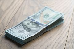 Bunch of dollars on oak wood table royalty free stock photography