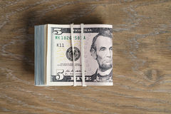Bunch of dollars on oak wood table royalty free stock photos