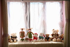 A bunch of dolls in the window Royalty Free Stock Photos