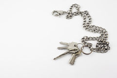 Bunch of door keys with chain isolated on white background Royalty Free Stock Image
