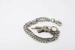 Bunch of door keys with chain isolated on white background Stock Images