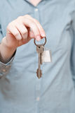 Bunch of door keys with key ring in hand Stock Images