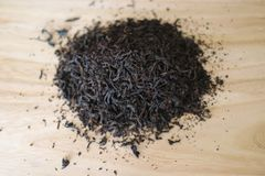 A bunch of dried black tea leaves stock image