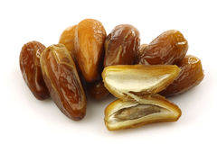 Bunch of dried dates and an opened one Royalty Free Stock Images