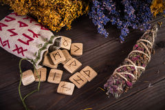 Bunch Of Dried Herb That Usually Is Used In Different Ritual, Magic And Cleaning, runes, old envelope with wax stamp. And candle Stock Photos