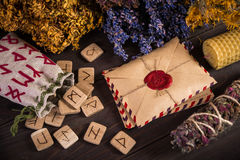 Bunch Of Dried Herb That Usually Is Used In Different Ritual, Magic And Cleaning, runes, old envelope with wax stamp. And candle Royalty Free Stock Photo