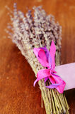 Bunch of dried lavender on brown wooden table Stock Images