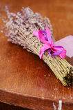 Bunch of dried lavender on brown wooden table Stock Photography