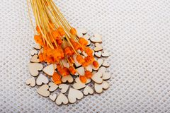 Bunch of dried orange color flower and heart shaped. Bunch of dried flower and heart on white background royalty free stock photos
