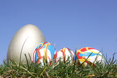 Bunch of eggs. Easter eggs in grass against  a bright blue sky Stock Photos