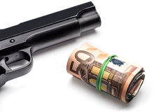 Bunch of euro banknotes with a gun Royalty Free Stock Image