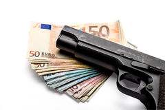 Bunch of euro banknotes with a gun. Bunch of euro banknotes of various denominations with a gun.  on white Stock Photo