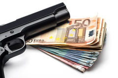 Bunch of euro banknotes with a gun Royalty Free Stock Photos
