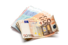 Bunch of euro banknotes of various denominations. On white Stock Image