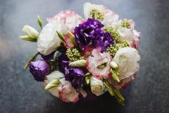 Bunch eustoma flowers in glass vase stock photo