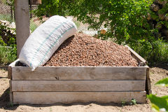 Bunch of expanded clay in a wooden box Royalty Free Stock Photography